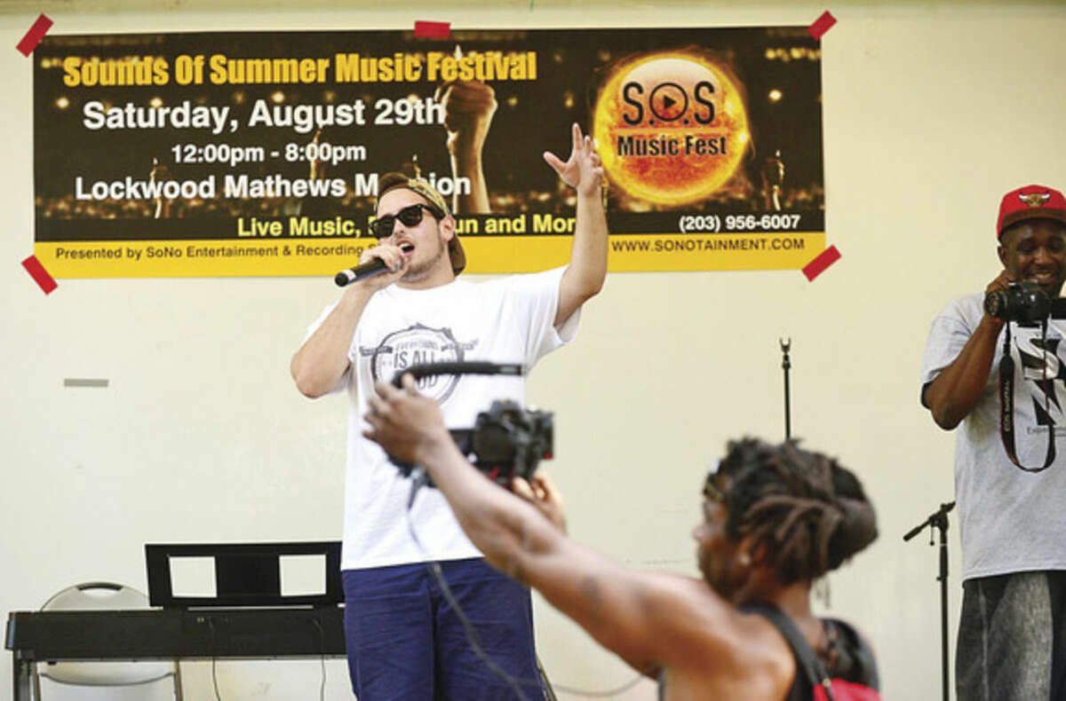 Hour photo / Erik Trautmann V Kay performs in the first Sounds of Summer Music Festival 10 hip hop artists from Norwalk and the surrounding towns performed at Mathews Park on Saturday afternoon and evening.