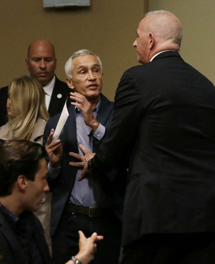 A security guard for Republican presidential candidate Donald Trump removes Miami-based Univision anchor Jorge Ramos, left, from a news conference, Tuesday, Aug. 25, 2015, in Dubuque, Iowa. Ramos stood up and began to ask Trump about his immigration proposal. (AP Photo/Charlie Neibergall)