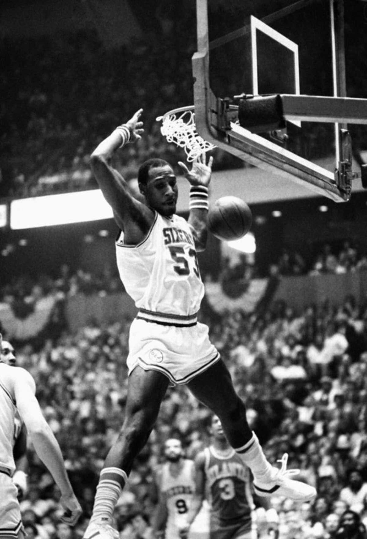 FILE - In this April 15, 1980, file photo, Philadelphia 76ers' Darryl Dawkins dunks against the Atlanta Hawks in an NBA playoff game in Philadelphia. Darryl Dawkins, whose backboard-shattering dunks earned him the moniker