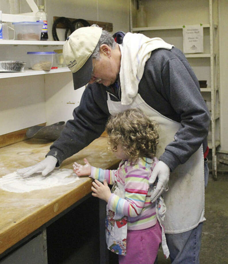Contributed photoFrank Whitman, owner of Silvermine Tavern, works with his granddaughter Moira in the kitchen. Moira was the fourth generation of Whitmans to work in the kitchen at the historic tavern.