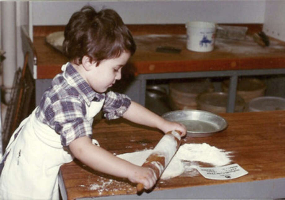 Contributed photoBertram Whitman, son of owner Frank Whitman, rolls out some dough years ago at Silvermine Tavern.