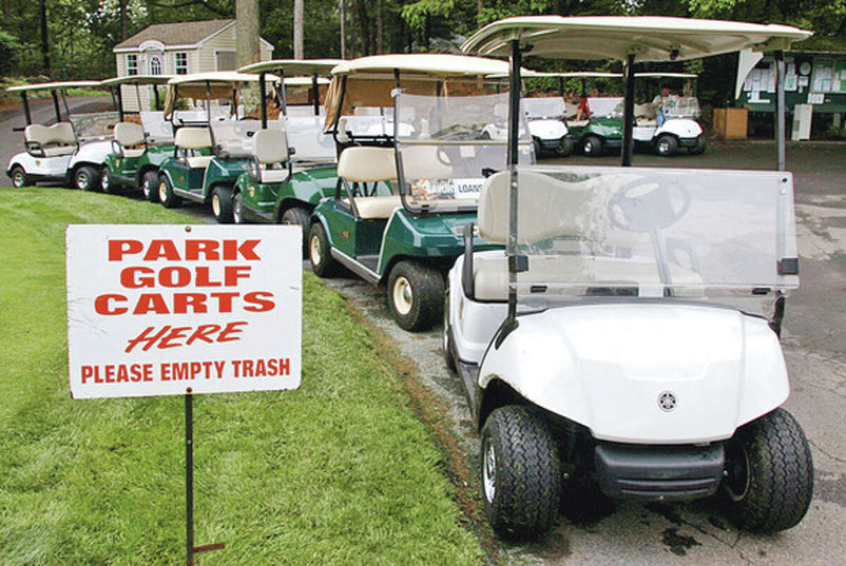 Hour photo / Erik Trautmann The city of Norwalk approved a second debt-restructuring for Oak Hills Park Authority. The authority will hire a new golf pro and is poised to receive new golf carts.