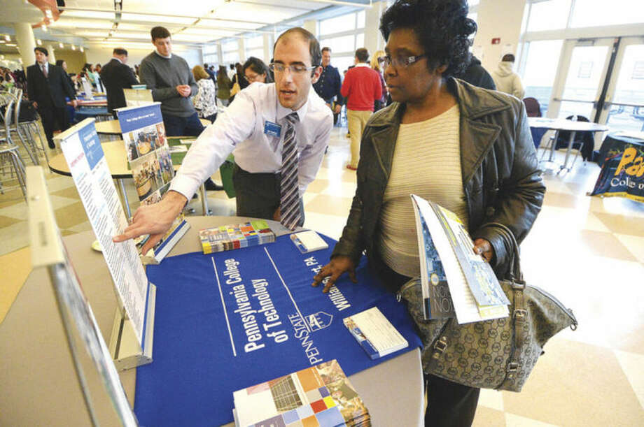 Hour Photo/Alex von Kleydorff Mark Capellazi talks about Penn College of Technology with Carolyn Mack at the citywide college fair at Brien McMahon