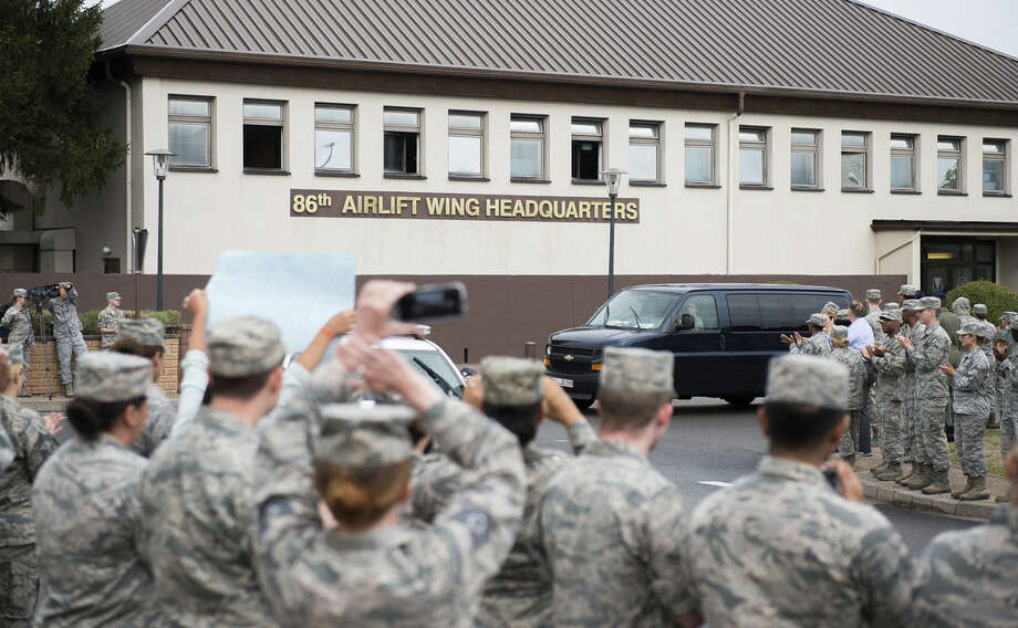 "In this Aug. 24, 2015 picture, provided by U.S, Airforce Ramstein , Airman 1st Class Spencer Stone is greeted with a ""Heroic Welcome"" as he and Oregon National Guardsman Aleksander Skarlatos arrive at Ramstein Air Base, Germany. More than 200 Airmen and their families came out to line the streets and thank Stone and his friends for their bravery. Stone arrived at Ramstein while in transit to Landstuhl Regional Medical Center for follow-on medical treatment. Stone received multiple injuries, all of which were non-life threatening, while subduing an armed gunman on a train traveling from Amsterdam to Paris. (Staff Sgt. Sara Keller/U.S. Air Force via AP) MANDATORY CREDIT"