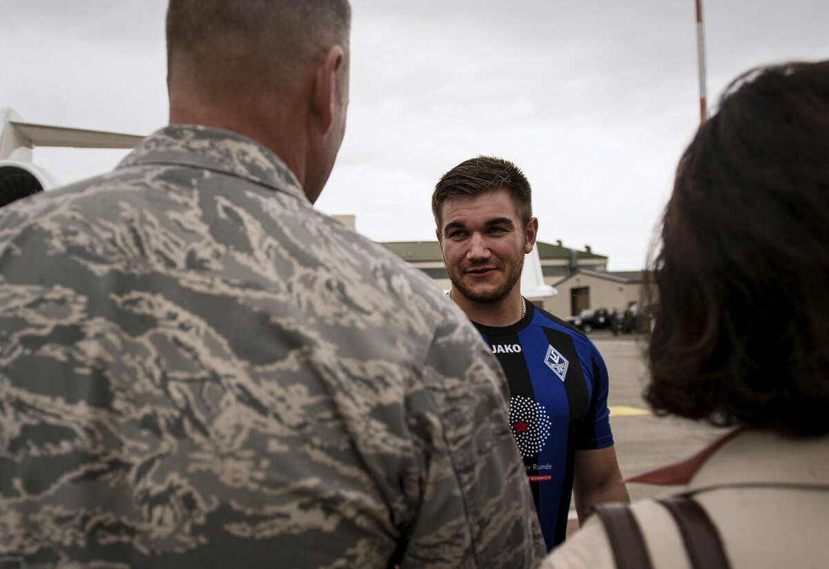 Staff Sgt. Sara Keller/U.S. Air Force via AP In this Aug. 24 photo, provided by U.S, Airforce, National Guardsman Aleksander Skarlatos, right, meets Brig. Gen. Jon T. Thomas, 86th Airlift Wing commander, as he arrives at Ramstein Air Base, Germany.