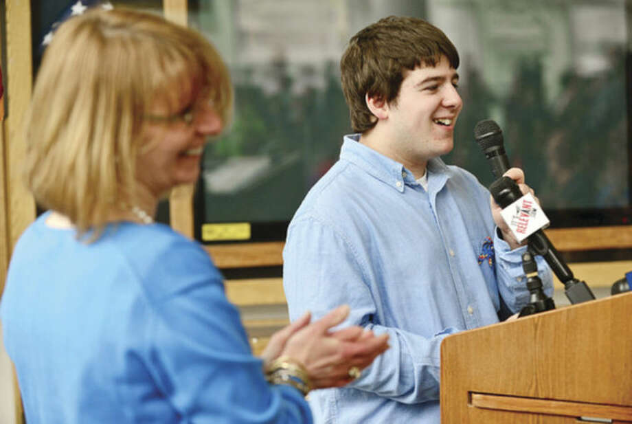 Hour photo / Erik Trautmann College student Anthony Portanova sepaks to the crowd gathered for the Stamford Education 4 Autism World Autism Awareness Day celebration at the Stamford Government Center Wednesday morning. Special guest speakers include Mayor David Martin, Superintendent of schools Dr. Winifred Hamilton, Jerry Pia of Board of Education and Stamford Education 4 Autism Buddies. Martin to receive recognition award from Stamford Education 4 Autism.