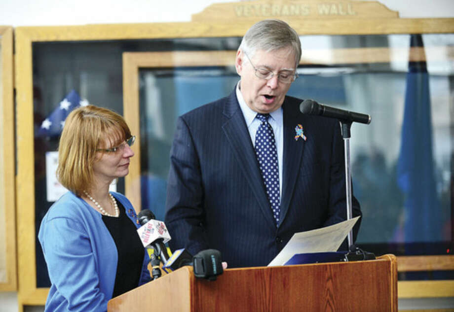Hour photo / Erik Trautmann Stamford Education 4 Autism (SE4A) president Robin Portanova honors Mayor David Martin as SE4A hosts a World Autism Awareness Day celebration at the Stamford Government Center Wednesday morning. S