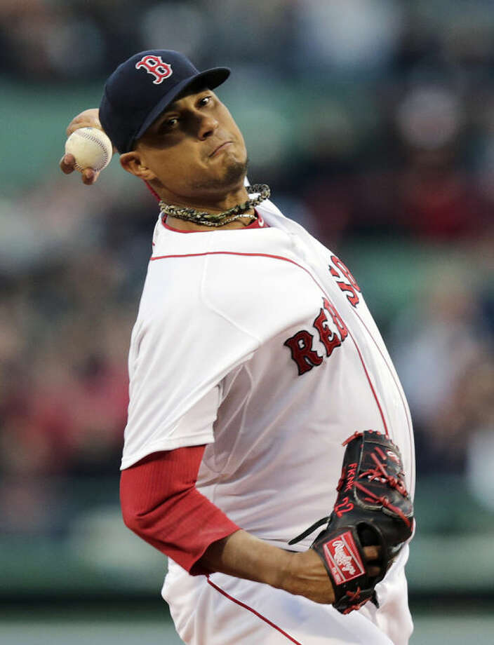 Boston Red Sox starting pitcher Felix Doubront delivers to the New York Yankees during the first inning of a baseball game on Thursday, April 24, 2014, in Boston. (AP Photo/Charles Krupa)
