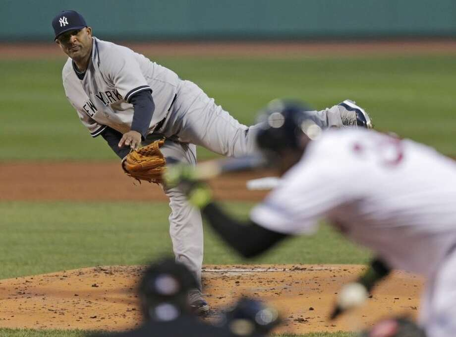 New York Yankees starter CC Sabathia, top, follows through as he hits Boston Red Sox designated hitter David Ortiz, right, with a pitch during the first inning of a baseball game on Thursday, April 24, 2014, in Boston. (AP Photo/Charles Krupa)