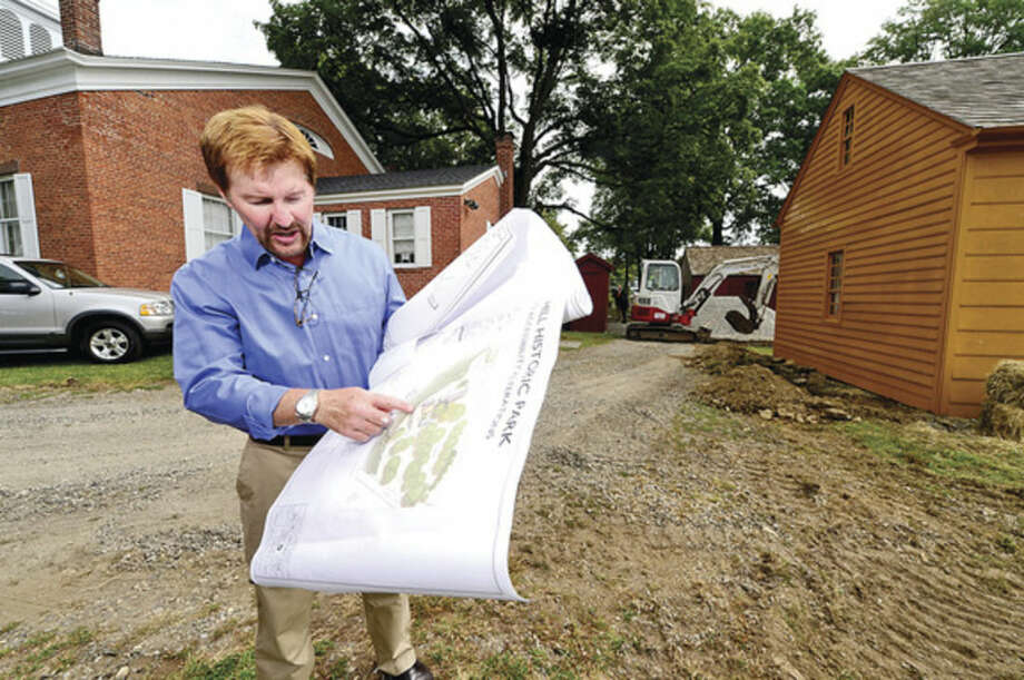 Hour photo / Erik Trautmann Norwalk Historical Society president David Westmoreland shows the plans for renovations to the Mill Hill historic park making it handicap accessible Thursday.