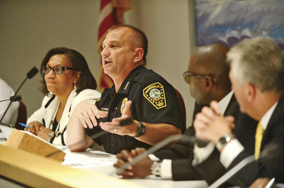 Hour photo / Erik Trautmann Norwalk Police Chief Thomas Kulhawik comments as The Norwalk Branch NAACP sponsors a Town Hall Meeting at City Hall Thursday night to discuss views and concerns regarding recent national incidents including the shooting death of Michael Brown in Ferguson.