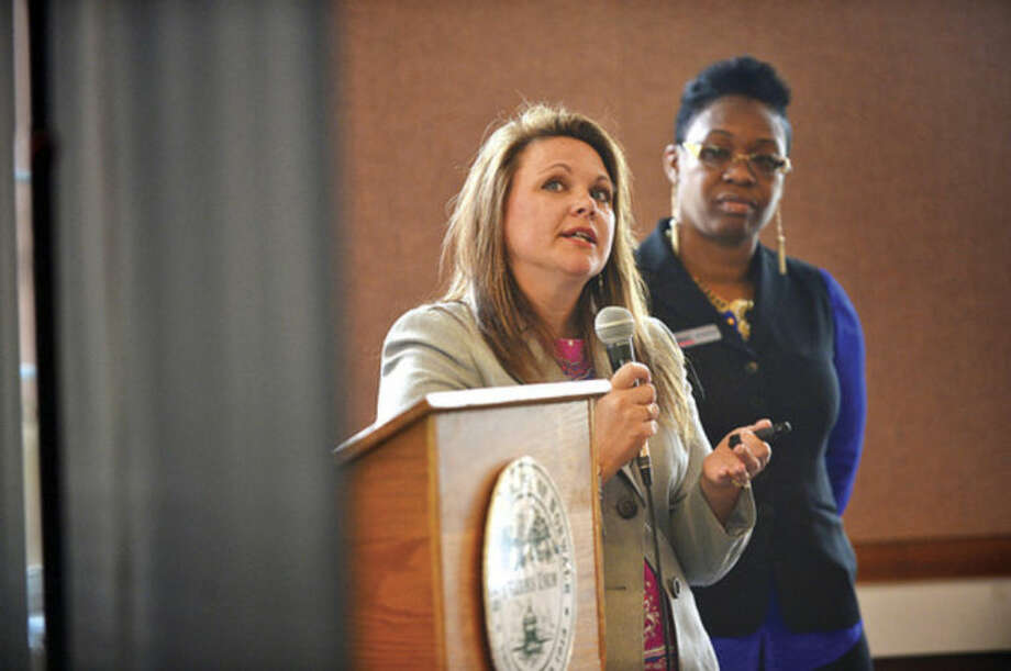 "Hour photo / Erik Trautmann Jacqui Torcellini International Trade Assistant with SBDC and Jenefeness Houston, Business Advisor with SBDC speak during the SCORE Fairfield County free Small Business Workshop and Expo, ""Getting Government Help For Your Small Business"" at Norwalk City Hall Wednesday. The program shows which loan, grant or strategic service may help local businesses with presentations from Fairfield County SCORE; Small Business Administration Loan Program; CT Department of Economic & Community Development; Connecticut Innovations (SBIR) Grant Programs; CT Procurement and Technical Assistance Program and The Department of Commerce Export Assistance and SBDC Export Assistance."