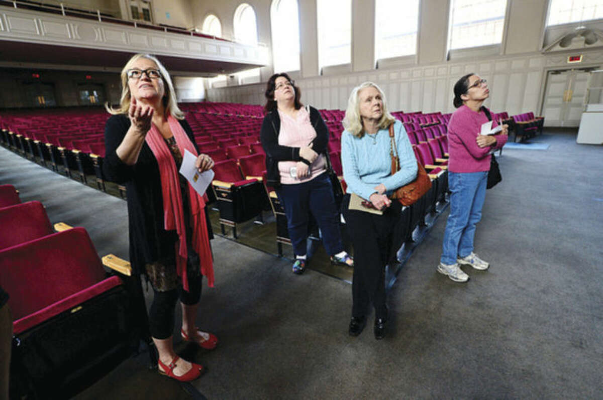 Hour photo / Erik Trautmann Former museum educator from the Aldrich Museum in Ridgefield, Suzanne Enser Ryan, right, conducts a Norwalk Arts Commission tour guide training session for Works Progress Administration artwork at City Hall for 10 prospective docents Wednesday.
