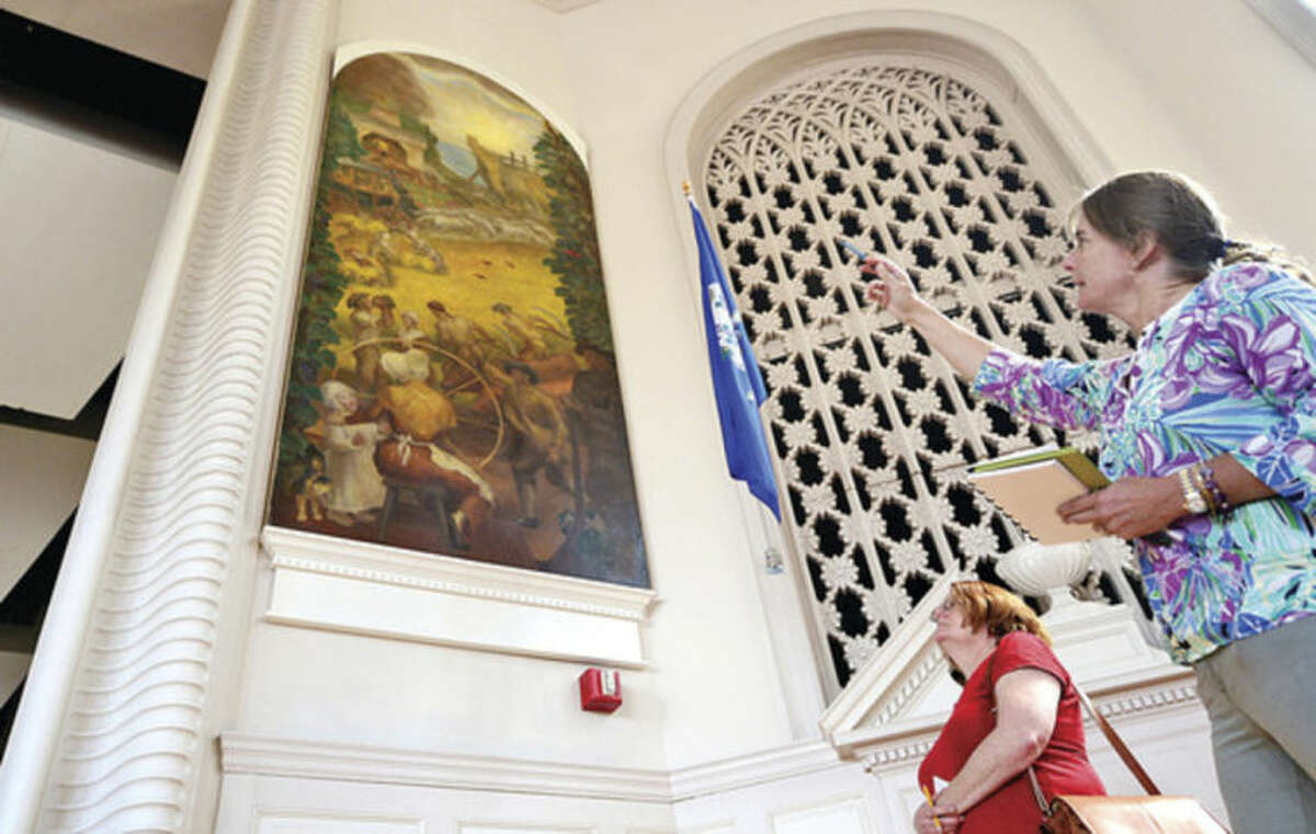 """Hour photo / Erik Trautmann Lisa Wilson Grant comments on the WPA mural, """"Ancient Industry"""", by John Steuart Curry as she participates in a Norwalk Arts Commission tour guide training session fat City Hall for 10 prospective docents Wednesday."""