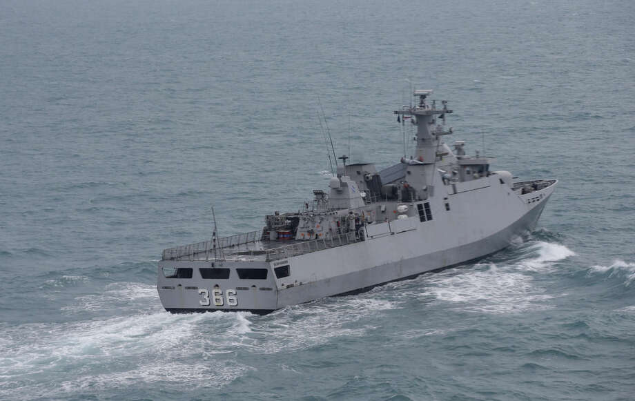 Indonesian Navy ship KRI Sultan Hasanuddin sails on the Java Sea during a search operation for the victims of AirAsia Flight 8501, off Pangkalan Bun, Central Borneo, Indonesia, Tuesday, Jan. 6, 2015. The Singapore-bound plane crashed into the sea 42 minutes after taking off on Dec. 28. (AP Photo/Achmad Ibrahim, Pool)