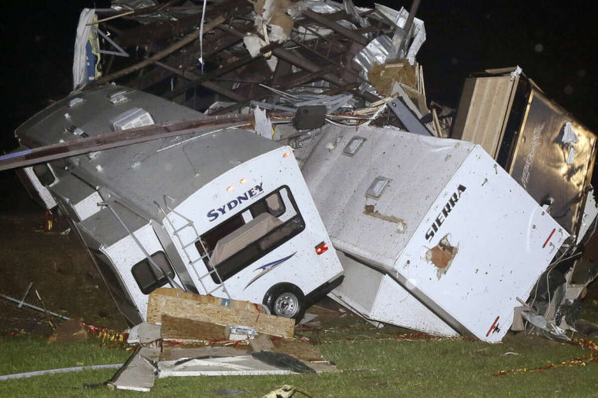 Travel trailers and motor homes are piled on top of each other at Mayflower RV in Mayflower, Ark., Sunday, April 27, 2014.A powerful storm system rumbled through the central and southern United States on Sunday, spawning tornadoes. (AP Photo/Danny Johnston)
