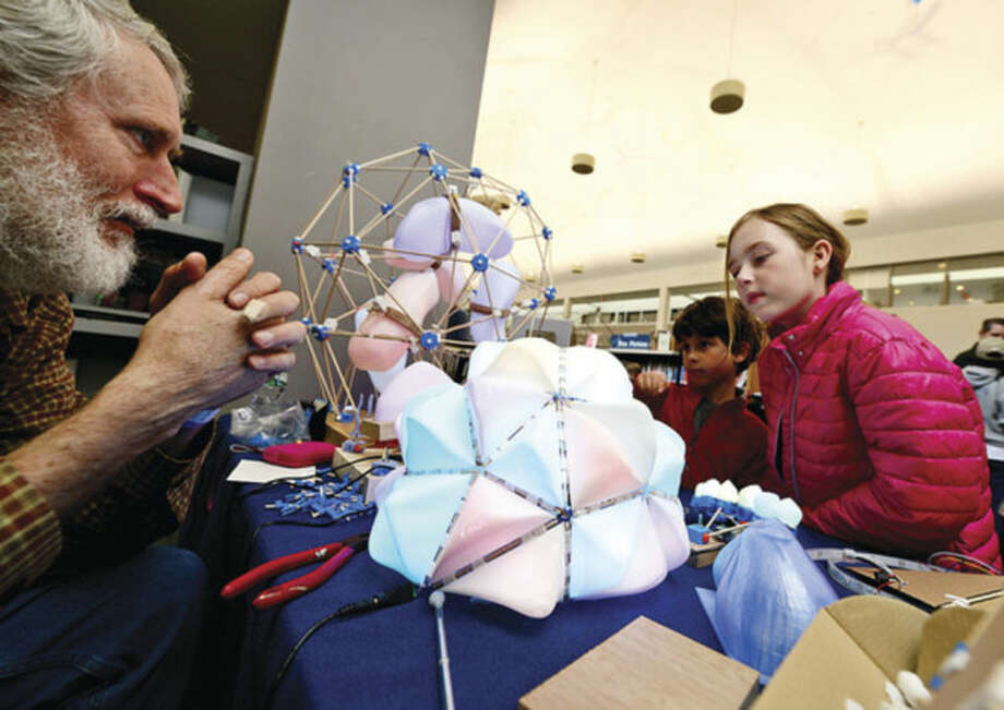 Hour photo / Erik Trautmann Madelyn Spera and her brother Luke check out light scuptures from Fred Bartels at the annual Mini Makers Faire at the Jessup Green in Westport Saturday.