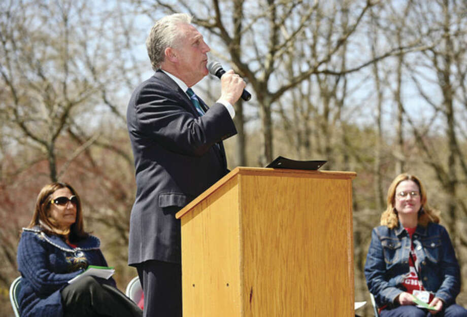 Hour photo / Erik Trautmann Norwalk Mayor Harry Rilling speaks as the Norwalk Tree Advisory Committee, the Norwalk Tree Alliance and the Norwalk Public Schools conduct an Arbor Day Celebration at Wolfpit Elementary School Friday. The program featured a proclamation from Mayor Harry Rilling, remarks by Schools Superintendent Dr. Manuel Rivera, poster contest prizes and the planting of a tree.