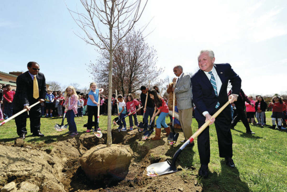 Hour photo / Erik Trautmann Norwalk Mayor Harry Rilling takes part in a tree planting ceremony as the Norwalk Tree Advisory Committee, the Norwalk Tree Alliance and the Norwalk Public Schools conduct an Arbor Day Celebration at Wolfpit Elementary School Friday. The program featured a proclamation from Mayor Harry Rilling, remarks by Schools Superintendent Dr. Manuel Rivera, poster contest prizes and the planting of a tree.