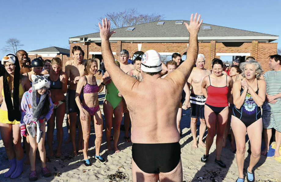 Hour photo / Erik TrautmannRobin Myers organizes the 11th Annual Team Mossman Polar Plunge at Compo Beach in Westport Thursday to benefit Save the Children. The second polar plunge Thursday by Westport Temple Israel raised over $70,000 for the Child Guidance Center of Mid-Fairfield County.