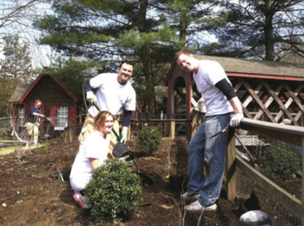Contributed photo Diageo employees volunteer at Beardsley Zoo on Tuesday.