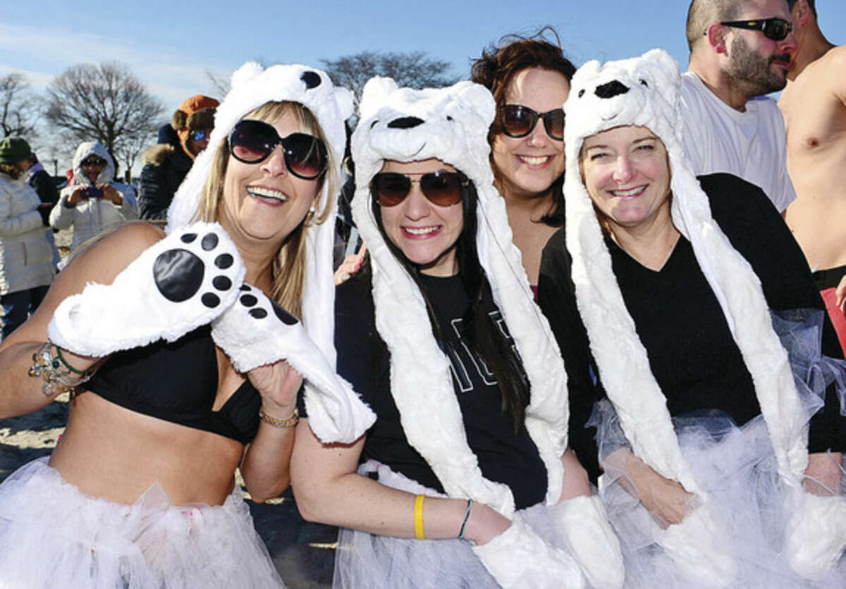 Hour photo / Erik Trautmann Shari Konn, Lauren Farasciano, Keenen McMahon and Ellen Swan of the Child Guidance Center prepare for the 8th Annual Temple Israel (TI) Polar Bears Plunge to benefit Child Guidance Center of Mid-Fairfield County at Compo Beach in Westport Thursday. The other polar plunge held Thursday was organized by Team Mossman and raised money for the Save the Children.
