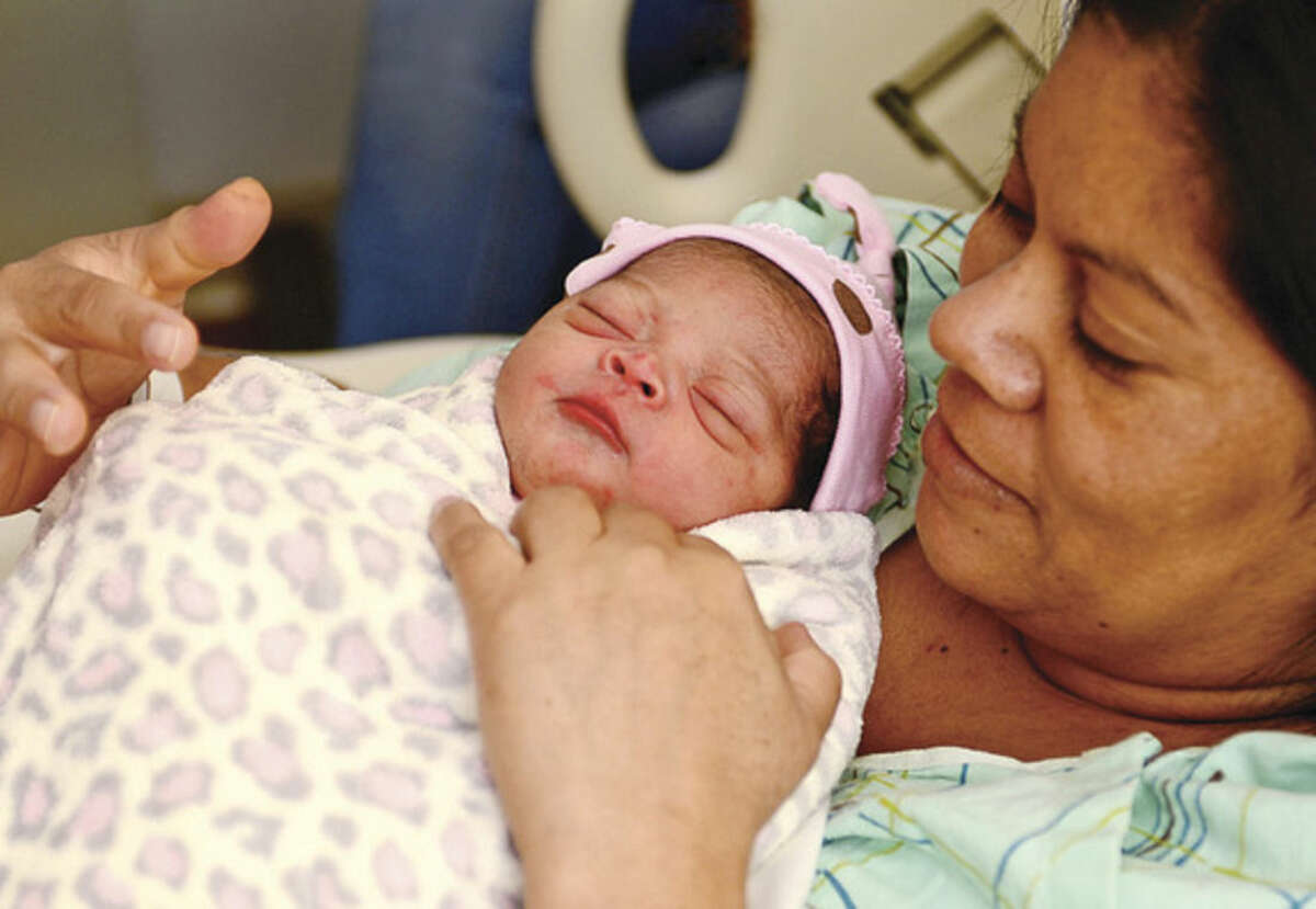 Hour photo / Erik Trautmann Nora Rodriguez celebrates the birth of her daughter, Ella Amaya-Rodriguez, who was the first baby born in Norwalk this year.