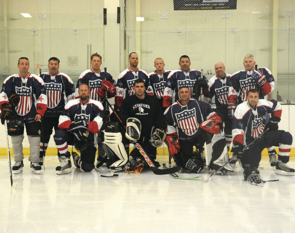 Hour photo / Matthew Vinci The Norwalk Police hockey team Sunday at the Human Services Council's Pucks For Prevention Charity Hockey Game to benefit the Children's Connection.