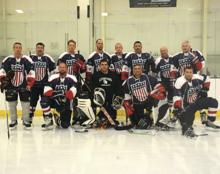 Hour photo / Matthew VinciThe Norwalk Police hockey team Sunday at the Human Services Council's Pucks For Prevention Charity Hockey Game to benefit the Children's Connection.