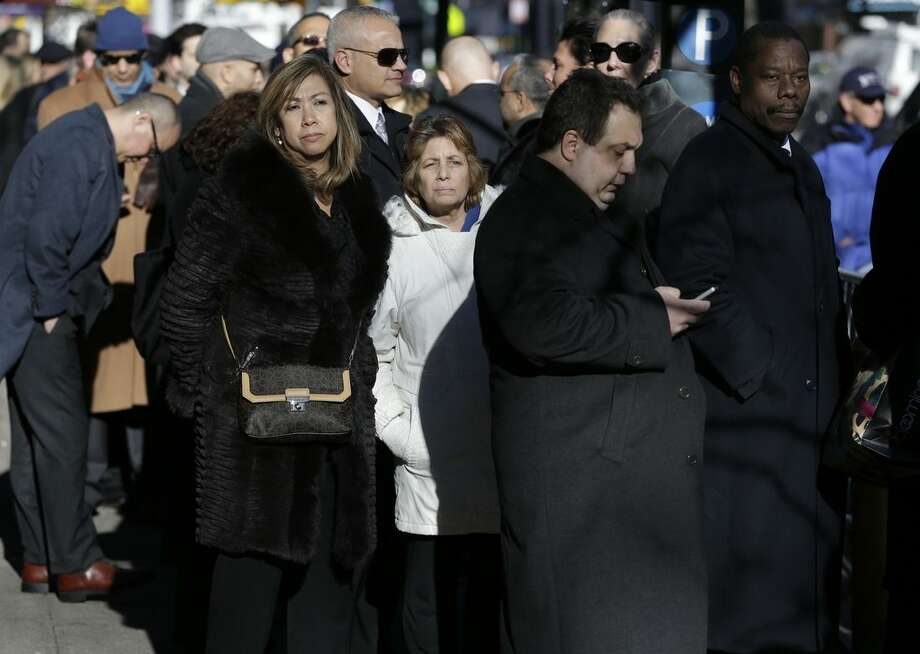 Attendees wait in line during the wake of former New York Gov. Mario Cuomo, Monday, Jan. 5, 2015, in New York. (AP Photo/Seth Wenig)