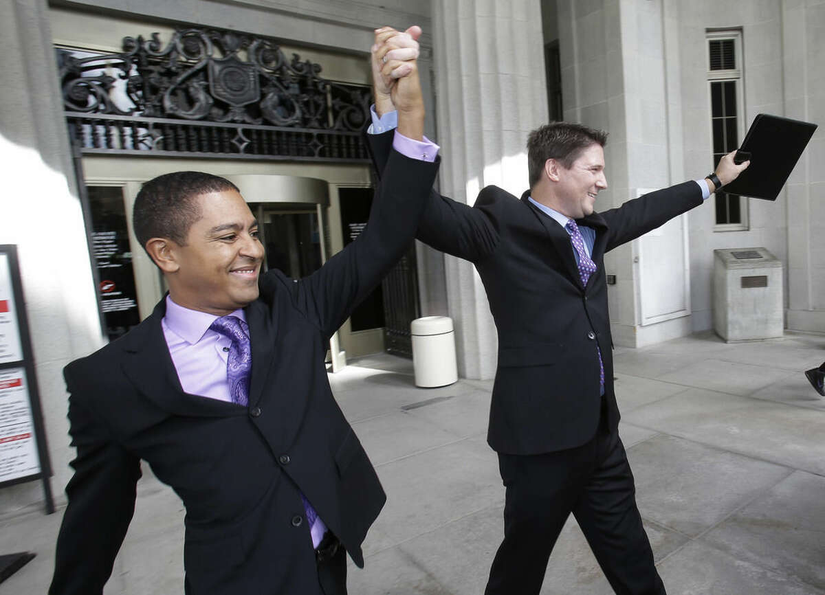 Todd, left, and Jeff Delmay, celebrate as they leave the courthouse after having attended a hearing in which a Miami-Dade Circuit Judge cleared the way for a gay and lesbian couples to marry, Monday, Jan. 5, 2015, in Miami. Judge Sarah Zabel provided a jump-start Monday to Florida's entry as the 36th state where gays and lesbians can legally marry, saying she saw no reason why same-sex couples couldn't immediately get their licenses in Miami-Dade County ahead of a midnight launch statewide. (AP Photo/Wilfredo Lee)