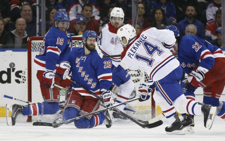 New York Rangers center Dominic Moore (28) and defenseman Marc Staal (18) block a shot by Montreal Canadiens center Tomas Plekanec (14) during the second period in Game 6 of the NHL hockey Stanley Cup playoffs Eastern Conference finals, Thursday, May 29, 2014, in New York. (AP Photo/Kathy Willens)