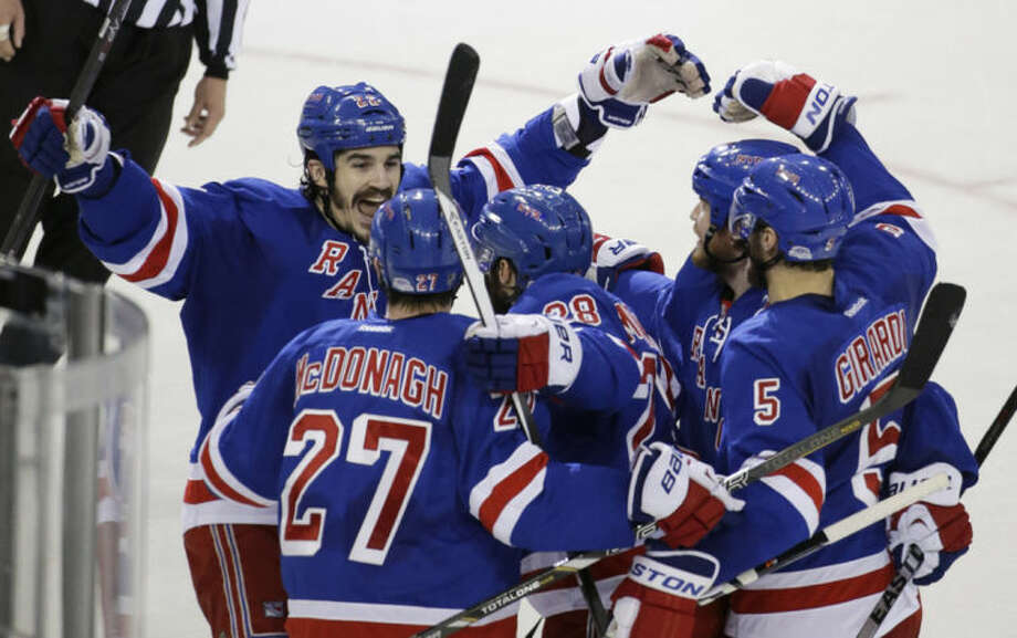 New York Rangers center Brian Boyle (22) celebrates with teammates after center Dominic Moore (28) scored a goal against the Montreal Canadiens during the second period in Game 6 of the NHL hockey Stanley Cup playoffs Eastern Conference finals, Thursday, May 29, 2014, in New York. (AP Photo/Frank Franklin II)