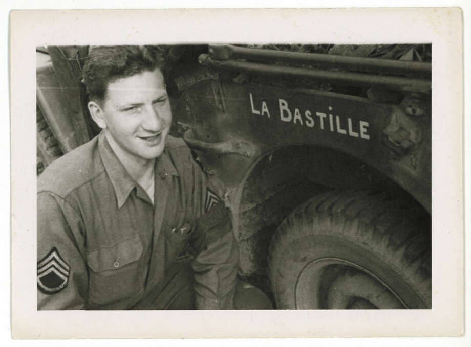 ADVANCE FOR STORY SLUGGED D-DAY FRENCH GI BY LORI HINNANT FOR RELEASE ON WEDNESDAY, MAY 28, 2014. In this photo dated July 1944 and provided by Dargols' family shows Bernard Dargols posing next to a Willys MB U.S. Army Jeep in Normandy, France. When the young Frenchman left Paris at age 18, the plan was to go to New York for a year and learn the sewing machine trade. Six years later, Bernard Dargols found himself crossing the English Channel in a U.S. Army uniform, sloshing ashore at Omaha Beach to a homeland that had stripped his Jewish family of their rights and sent some to die in concentration camps. This French GI, now in his 90s, recounts to AP his remarkable story. (AP Photo/Courtesy of Bernard Dargols' family)
