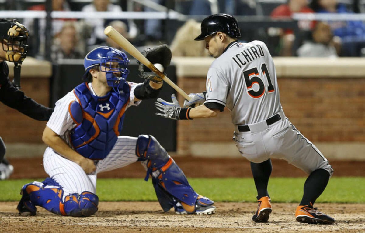 Miami Marlins Ichiro Suzuki (51) ducks to avoid a pitch as New York Mets catcher Travis d'Arnaud, left, catches the ball in the sixth inning of a baseball game in New York, Monday, Sept. 14, 2015. (AP Photo/Kathy Willens)