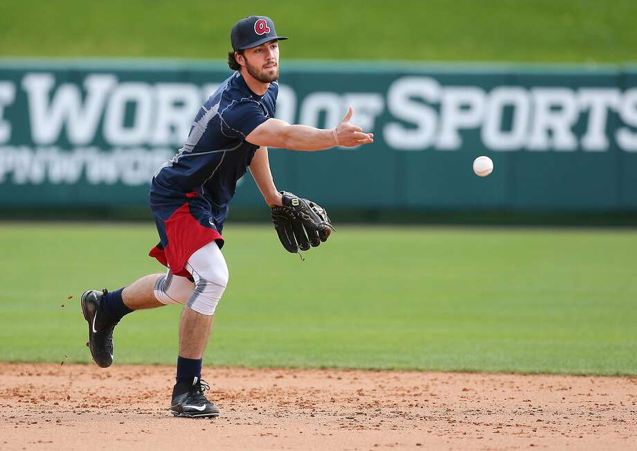 Braves prospect Dansby Swanson takes groundballs during spring training in February. Last year's No. 1 pick in the draft was recently promoted to Double-A Mississippi. Photo: Ccompton@ajc.com, AP