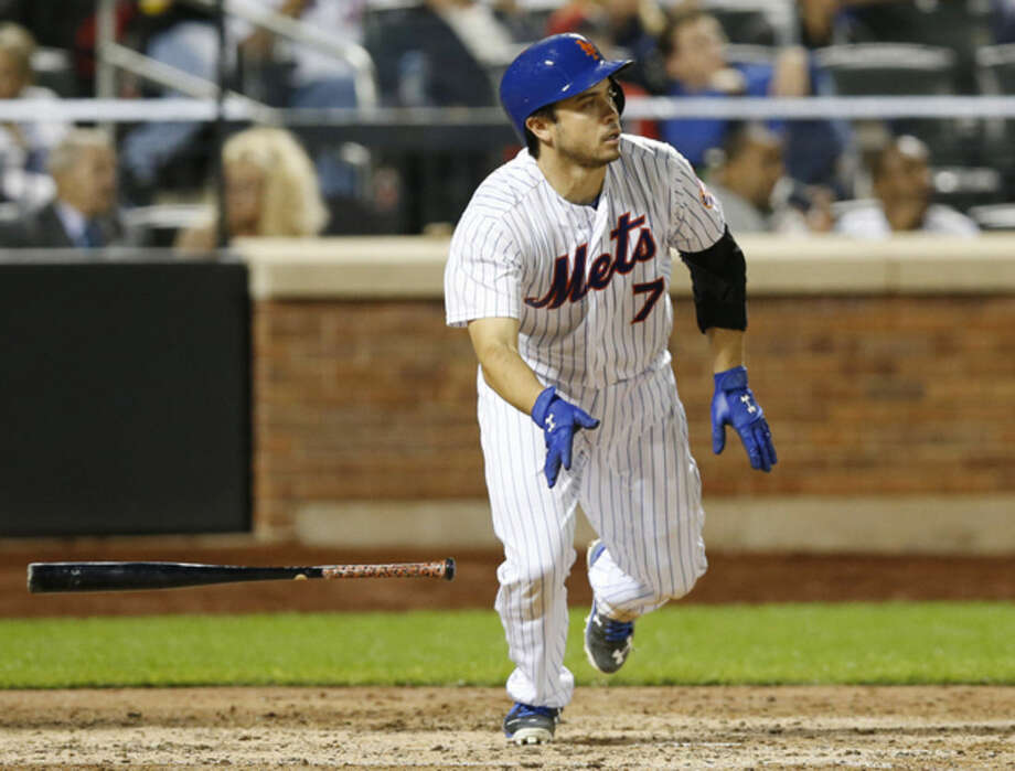 New York Mets Travis d'Arnaud drops his bat after hitting a sixth-inning, home-run off Miami Marlins pitcher Justin Nicolino in a baseball game in New York, Monday, Sept. 14, 2015. (AP Photo/Kathy Willens)