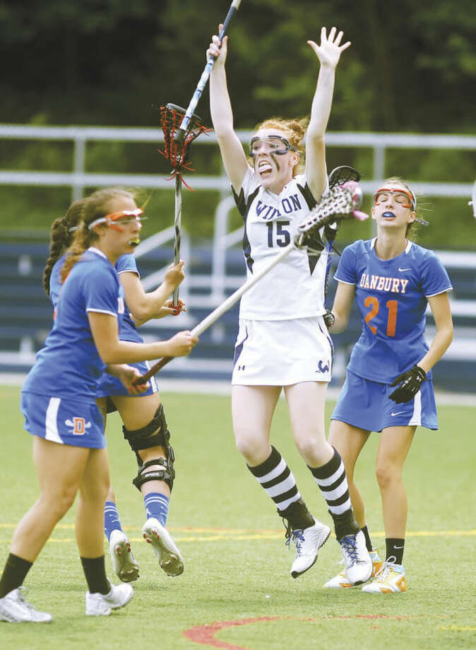 Hour photo/John NashWilton's Shannon Quinlan reacts after scoring one of her four goals during Friday's FCIAC girls lacrosse quarterfinal.