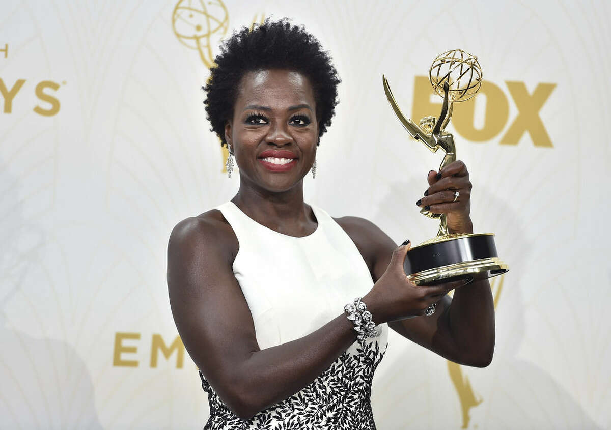 Viola Davis poses in the press room with the award for outstanding lead actress in a drama series for