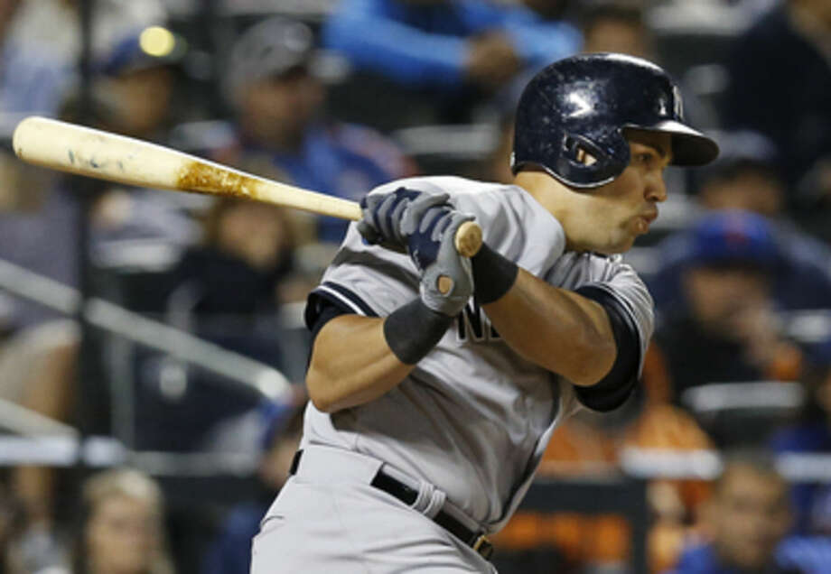 New York Yankees Carlos Beltran hits a sixth-inning, two-run double in a baseball game against the New York Mets in New York, Sunday, Sept. 20, 2015. (AP Photo/Kathy Willens)