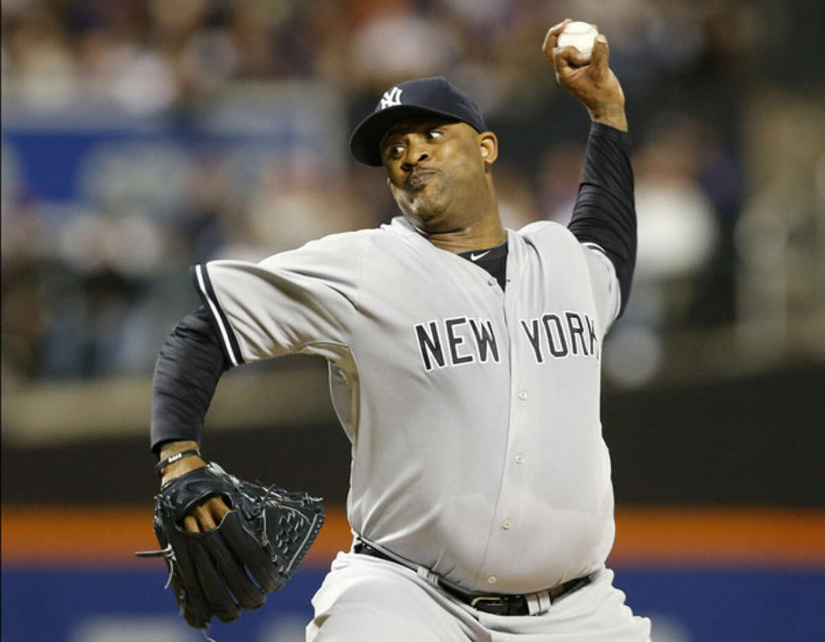 New York Yankees starting pitcher CC Sabathia delivers in the first inning of a baseball game against the New York Mets in New York, Sunday, Sept. 20, 2015. (AP Photo/Kathy Willens)
