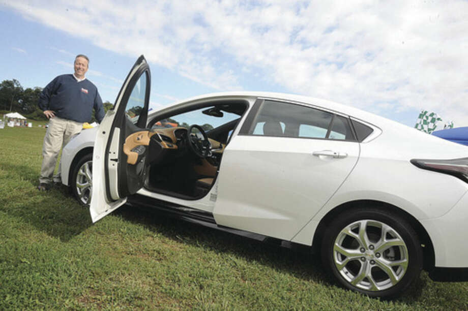 Leo E. Karl III, President Karl Chevrolet in New Canaan with the 2016 Chevrolet 2nd generation Volt car Sunday at the Live Green Connecticut! Festival at Taylor Farm in Norwalk. Hour photo/Matthew Vinci