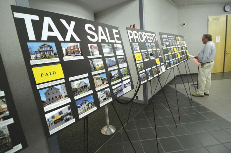 Hour Photo/Alex von Kleydorff Deliquent Tax properties are posted in the atrium at City Hall