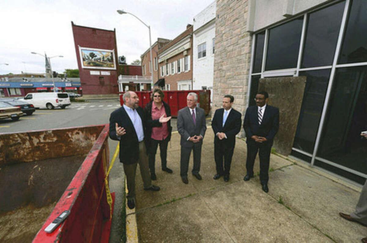 Hour photo/Erik Trautmann Kenneth Olson of POKO development announces demolition phase beginning in Wall Street area in Norwalk.