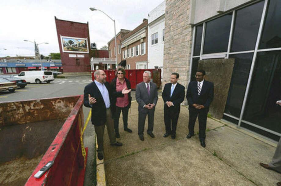 Hour photo/Erik TrautmannKenneth Olson of POKO development announces demolition phase beginning in Wall Street area in Norwalk.