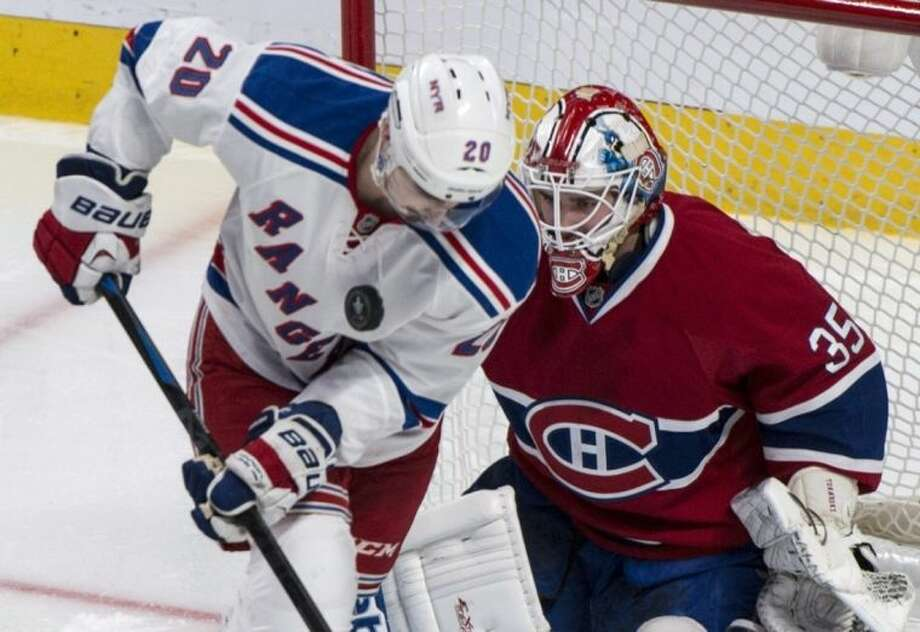 New York Rangers' Chris Kreider deflects the puck on his chest in front of Montreal Canadiens goalie Dustin Tokarski during the second period of Game 5 of the NHL hockey Stanley Cup playoffs Eastern Conference finals, Tuesday, May 27, 2014, in Montreal. (AP Photo/The Canadian Press, Paul Chiasson)