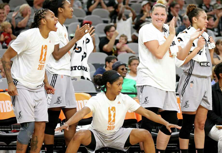Stars' Alex Montgomery (from left), Kayla Alexander, Sydney Colson, Jayne Appel-Marinelli, and Dearica Hamby celebrate after a basket during a first half action against the New York Liberty on June 11, 2016 at the AT&T Center. Photo: Edward A. Ornelas /San Antonio Express-News / © 2016 San Antonio Express-News