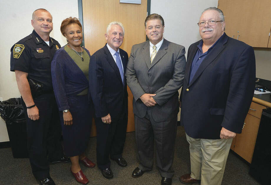 Hour Photo/Alex von Kleydorff Police Chief Tom Kulhawik Commissioner Fran Collier-Clemmons, Mayor Harry Rilling, Artie Kassimis, new Police Chaplain, Commissioner Charles Yost
