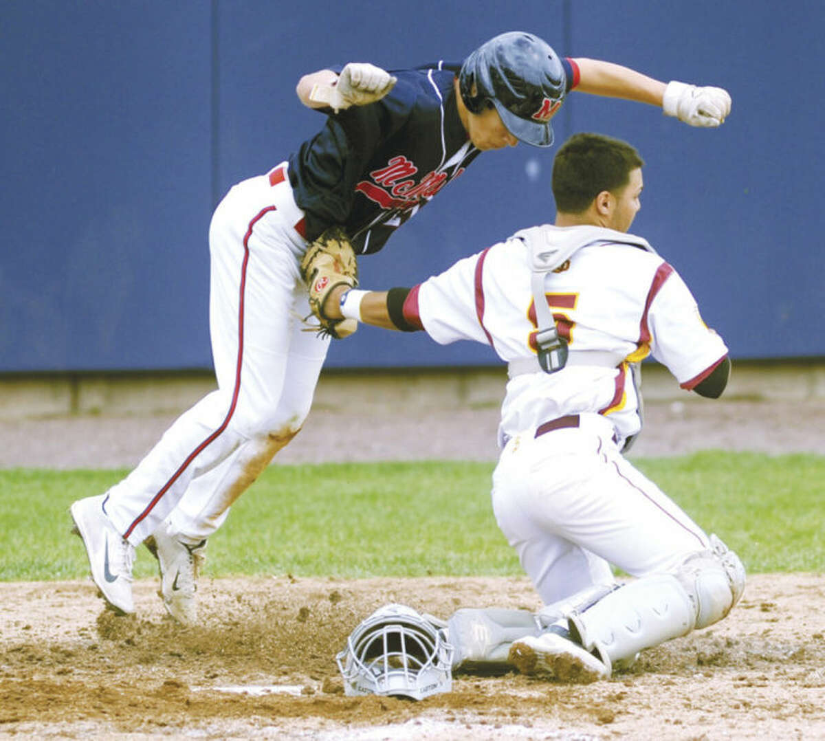 Hour photo/John Nash Brien McMahon base runner Drew Pace, left, is tagged out at home by St. Joseph catcher Ismael Herrara during the sevenh inning of Saturday's high school baseball regular season finale at The Ballpark at Harbor Yard in Bridgeport.