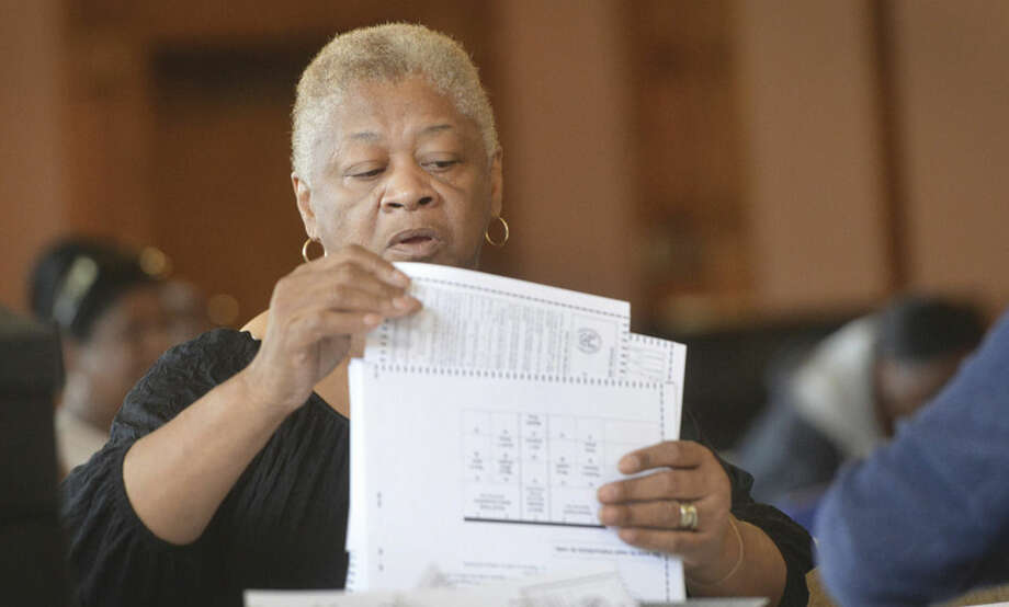 Hour Photo/Alex von Kleydorff Ruth Perry organizes some of the ballots during a recount of the tally at City Hall for Democratic primaries District A Common Council and Board of Ed and 2nd taxing district